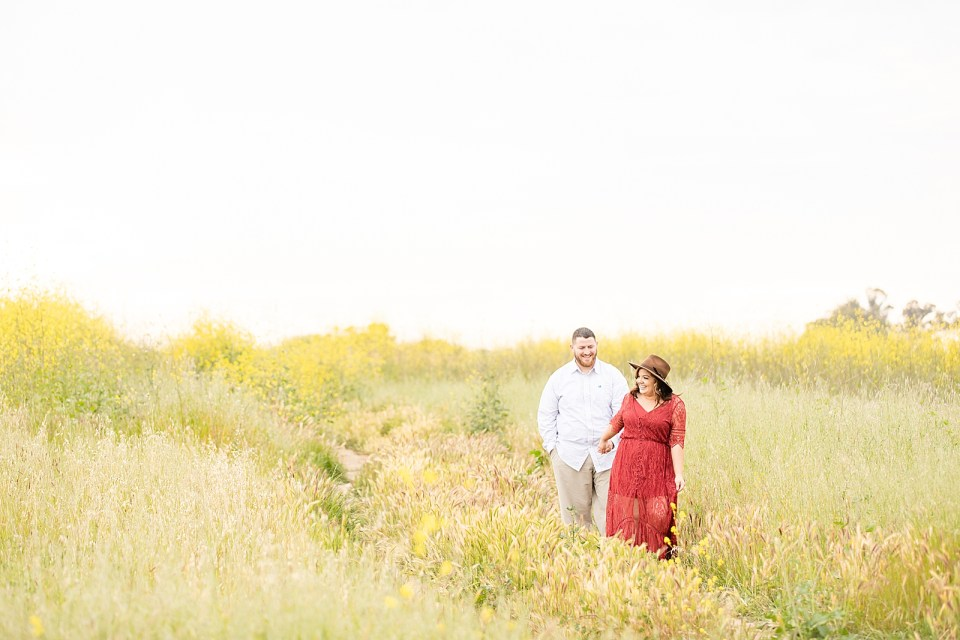 Maddy leading Brian along a path by the hand during their Ellwood Bluffs Engagement Session