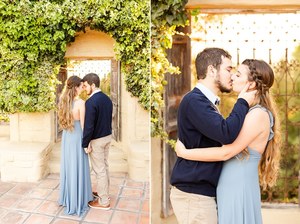 The couple is holding hands and forehead to forehead with their backs to the camera. The groom is holding his brides head and giving her a kiss as she wraps him up in a hug.