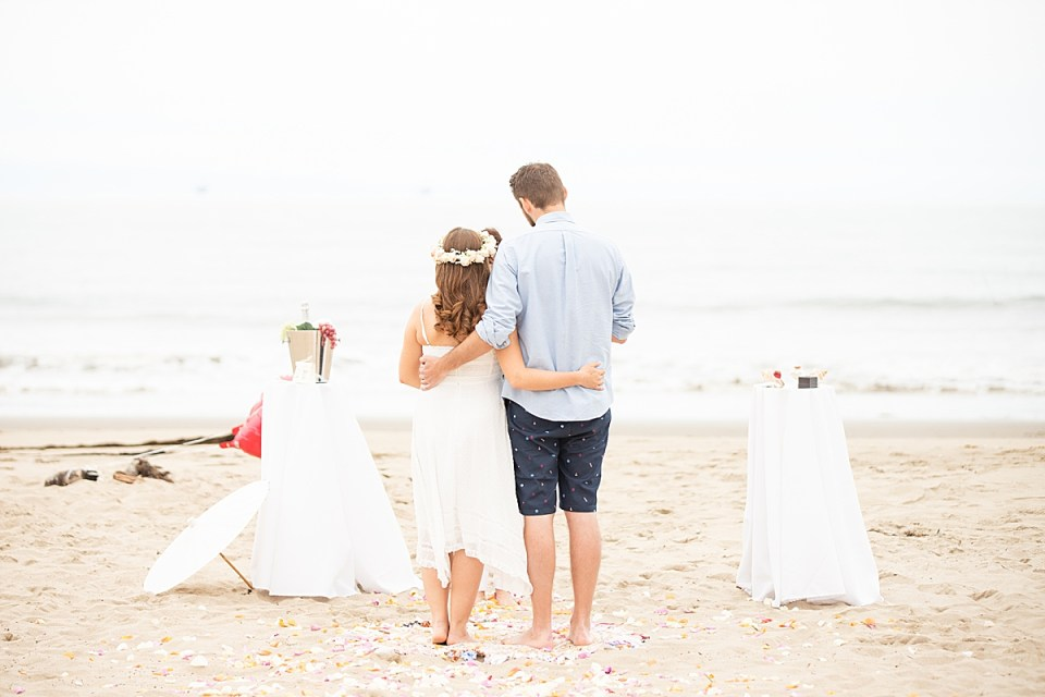 Gina & Michael during the ceremony of their Santa Claus Beach Elopement