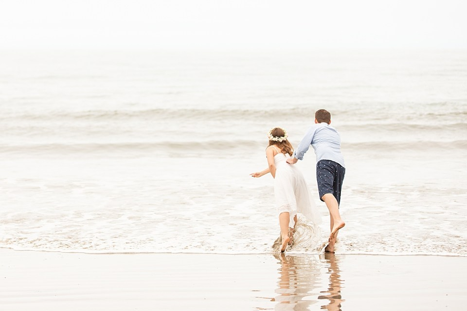 The couple tossing the sand dollars into the waves.