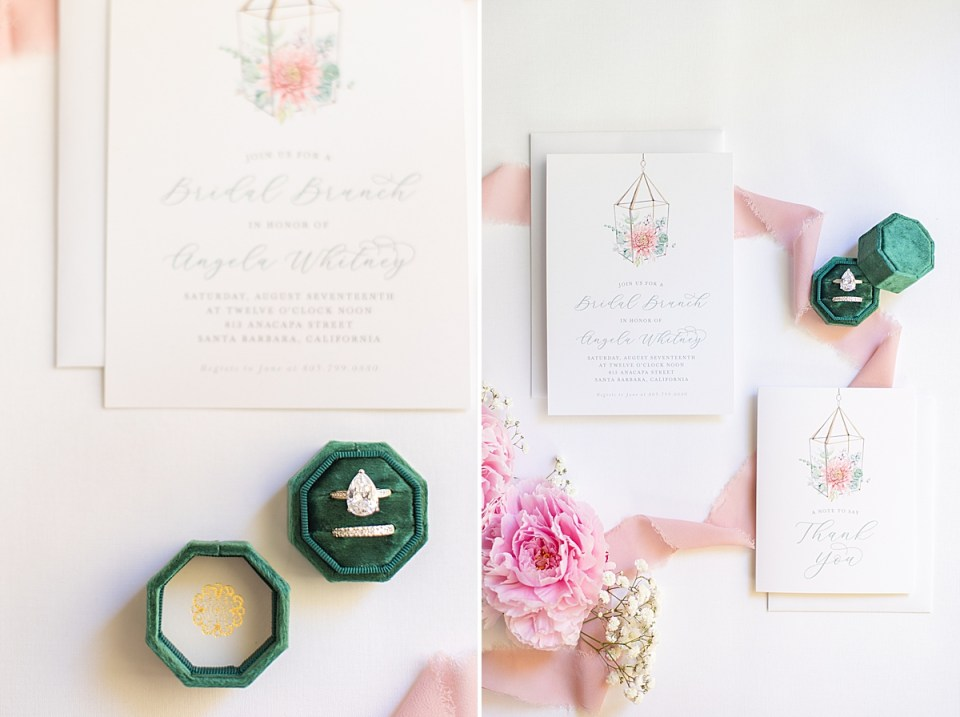 The bride & groom's invitation suite and some florals with pink lace scattered about.