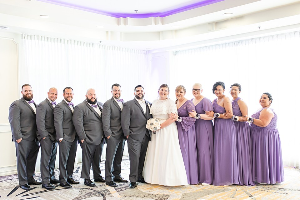 Betsy & Michael's with their full bridal party smiling at the camera
