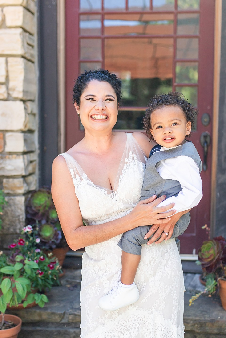 Brandi and her son smiling at the camera on her wedding day.