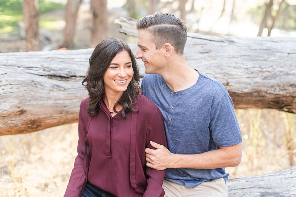 Scott smiling at his bride as she smiles over his shoulder during their Montaña de Oro engagement session