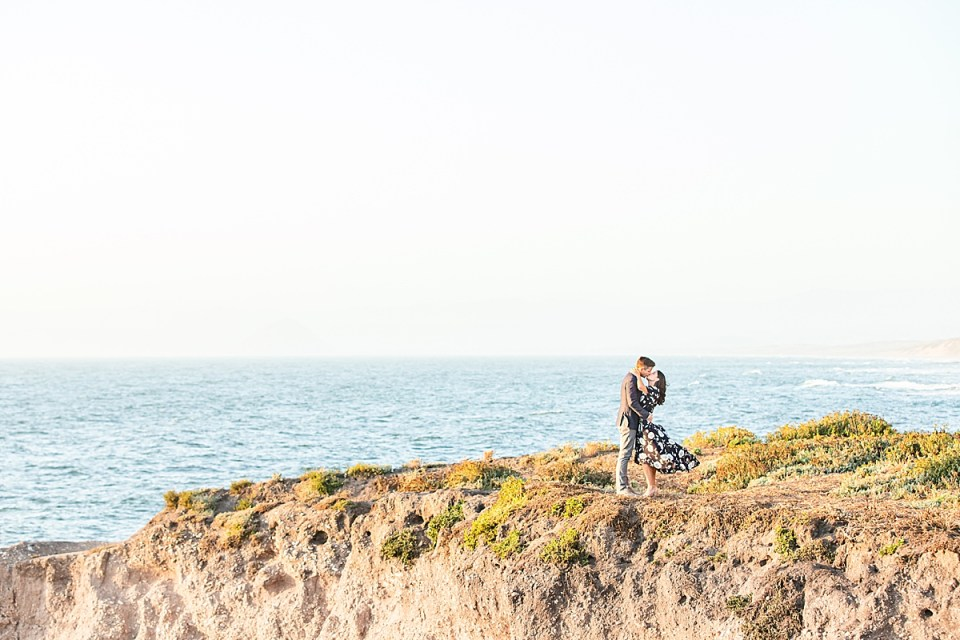 The couple sharing a moment on the bluffs at their Montaña de Oro engagement session.