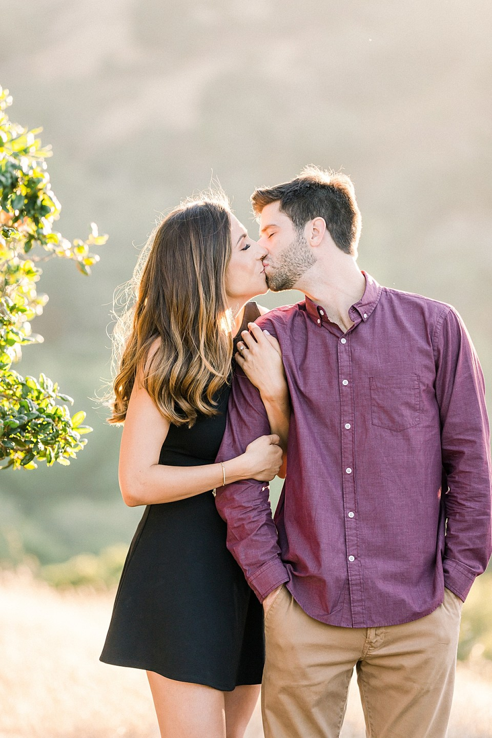 The couple sharing a kiss during their San Luis Obispo Bishop's Peak engagement session