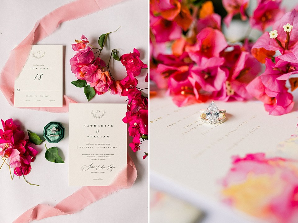 The couples Wedding Invitations surrounded by pink and red bougainvillea