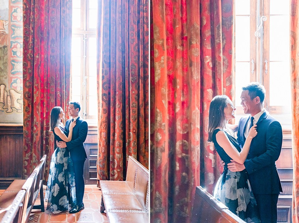 Erica & Gideon holding each other closely in the Mural Room during their Santa Barbara Courthouse Engagement session in Santa Barbara, California.