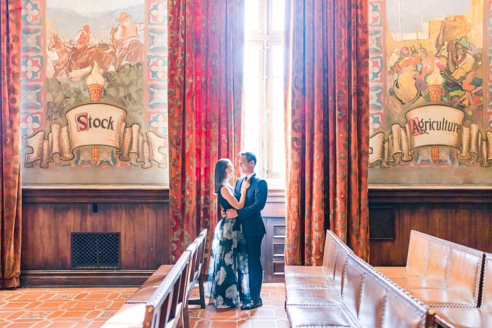 Light coming in through the window and landing on the couple as they embrace.