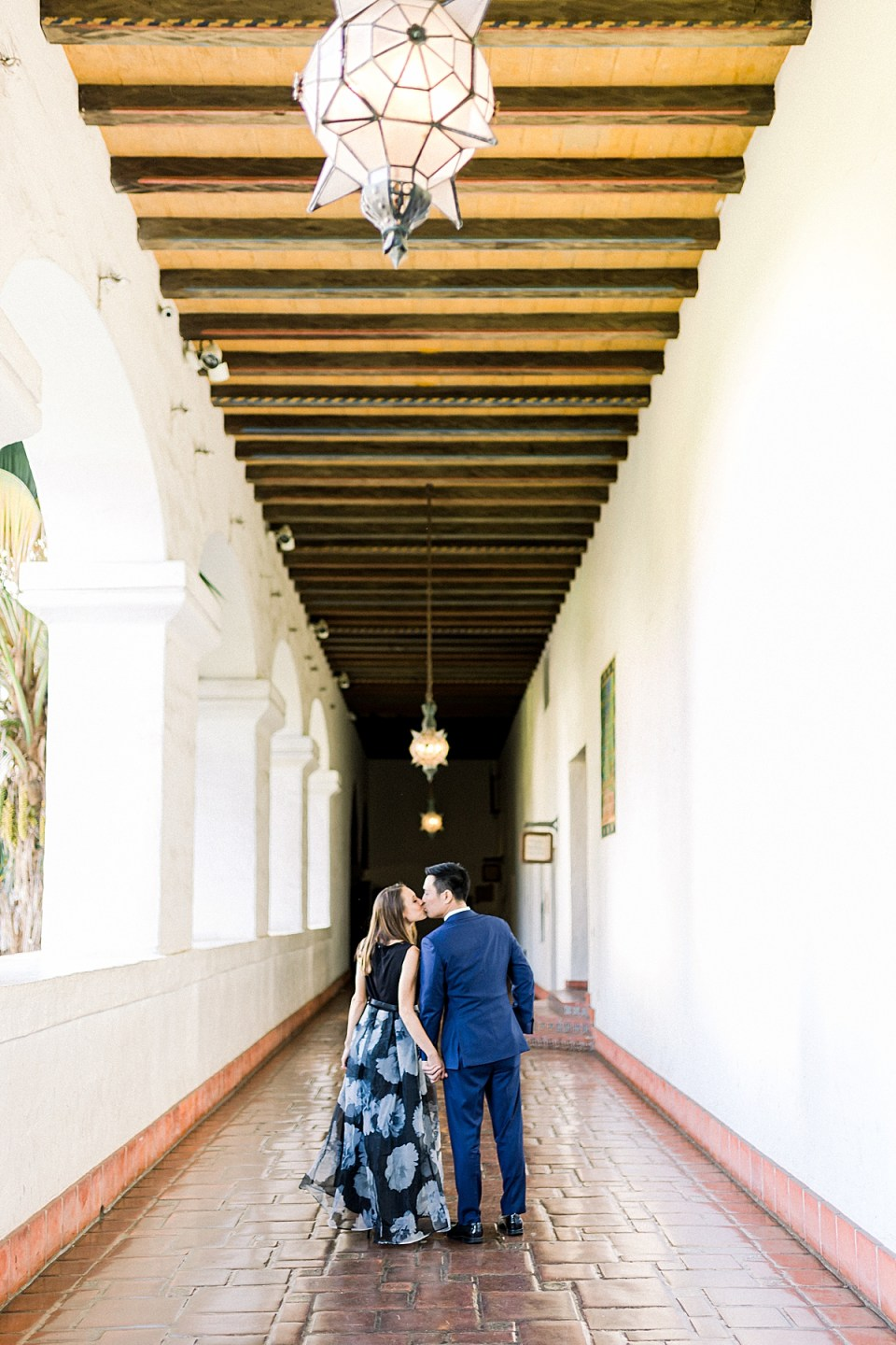 The couple sharing a kiss in the middle of the hallway during their Santa Barbara Courthouse Engagement session