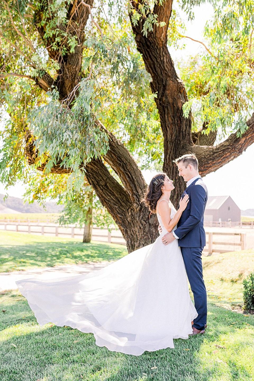 Lauren & Scott standing together facing each other during their San Luis Obispo Farm Wedding