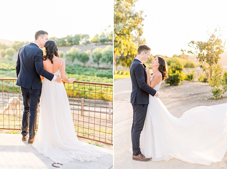 Scott leaning over to give Lauren a kiss on the top of her head as they both look out across the vineyards. A second image of Lauren laughing up at Scott as he holds her around the waist and smiles at her. The brides dress is flying up in the wind during their San Luis Obispo Farm Wedding