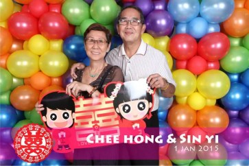instant photo booth with balloon backdrop