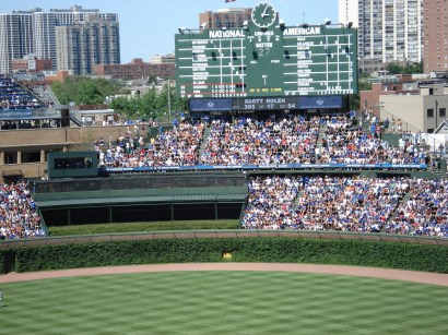 From this picture you can see the manually operated scoreboard, along with the ivy wall, two unique features the stadium is known for.