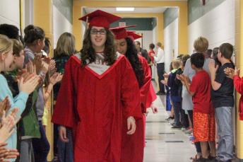 North Johnston High senior Jennifer Hooks walks the hall of Micro-Pine Level Elementary during Class of 2016 Senior Walk.