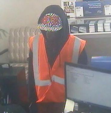 Surveillance camera images show a man robbing the First Citizens Bank on Main Street in Buies Creek Thursday.