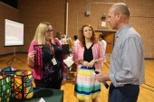 South Johnston High Math Teacher Kelly Bradshaw (left) and Art Teacher Emily Crews (center) share how they coordinated together to combine their curriculums to create stained glass lanterns with Wake County Public Schools Director of Curriculum Enhancement Paul Domenico (right).