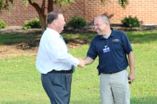 Superintendent Dr. Ross Renfrow (left) greets Brian Baker (right), Fire Alarm Technician for JCPS, on the first day of school.