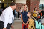 JCPS Superintendent Dr. Ross Renfrow (right) greets McGee's Crossroads Middle teacher Rachel Leeworthy (middle) and her daughter Izabella.