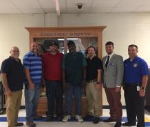 Community members gathered in front of the case (from left) Gary Good, Jay Brubaker, Joseph Daughtry, Therman Pearce, Mike Bullock, Cole Yarborough, and Jamey Wilkinson.