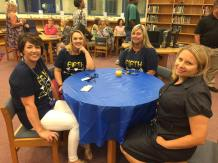 The school provided refreshments for the community after the unveiling ceremony. Photographed (from left) are Elisabeth Smith, Kendall Harr, Pam Creech, and Tabitha Phillips.