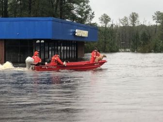 U.S. Coast Guard Shallow-Water Response Team 3 crew members rescued four pit bulls and eleven beagles from rising water caused by Hurricane Florence in Delco, North Carolina on Sunday. U.S. Coast Guard photo by Chief Petty Officer Stephen Kelly