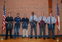 Fraternal Order of Police members stand together after packing 500 book bags with Johnston County Public Schools staff. From left are Robert Stewart, Brian O'Branovich, Ronald Daniels, Derek Mobley, Nate Hocutt, and Derek DelCastilho.