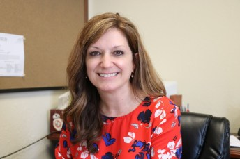 Stephanie Leonard at her desk in McGee's Crossroads.