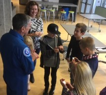 The homeschooled FIRST LEGO League team, the Ragnarblocks, received coins from Dr. Don Thomas after his presentation about working and living in space. Dr. Thomas, a veteran astronaut, coined more than 40 robotics students and their siblings during a presentation at Neuse Charter School on Nov. 12, 2018.