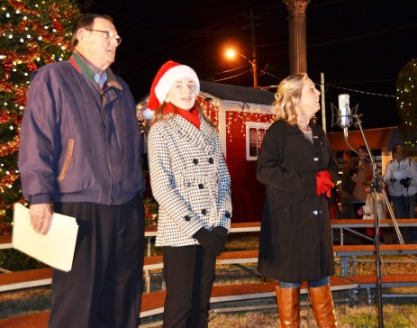 Benson Mayor Jerry Medlin, Ava Grace Jernigan and Ellen Allen led the crowd in the singing of Silent Night immediately after the town's Christmas tree was lit. It was a part of Benson's Christmas on Main celebration.