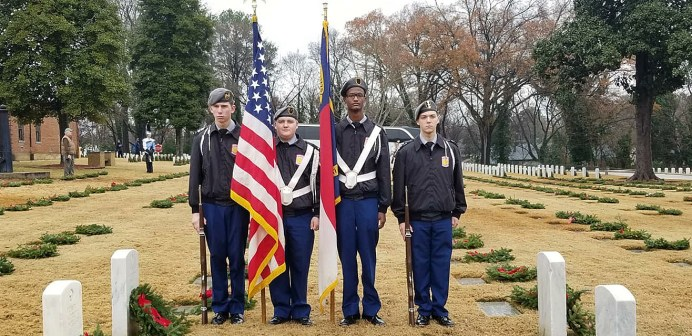 Cleveland High JROTC cadets (from left) Deondre Honomichl, Tanner Sponer, Johnquell Bell and Christopher Stahl stand in position to begin the ceremony.