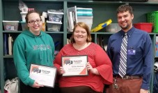 Teacher Pioneer Julie Della Rose (center) stands with Amy Stanley, Director of Digital Learning (left), and Four Oaks Elementary Principal Kathy Parrish (right) after receiving her grant.