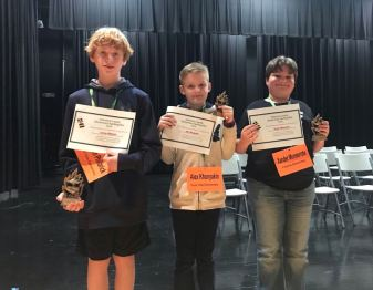 Students from 27 different elementary schools competed in the 2019 Johnston County Elementary Spelling Bee on Jan. 24 at Selma Elementary School. The first place winner of the Spelling Bee was West View Elementary student Carson Philbrick (left), the second place winner was River Dell Elementary student Alex Khonyakin (center), and the third place winner was Polenta Elementary student Xander Monserrate (right).