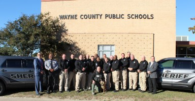 Superintendent Dr. Michael Dunsmore and Wayne County Sheriff Larry Pierce standing with WCSO SROs and supervisor support.