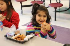 West Smithfield Elementary kindergarten student Mesk Sarama enjoys a school lunch.