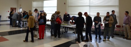 Residents of Four Oaks look over maps and gather information during an informational meeting with NCDOT officials Thursday. The meeting was held to give residents a look at plans for a proposed interchange upgrade at the U. S. 701/Interstate 95 interchange. The project is slated to begin in 2022.