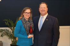 Stephanie Haumont (left), Media Specialist at Cleveland High, was selected as the Employee of the Year for her field. Standing with her is JCPS Superintendent Dr. Ross Renfrow (right).