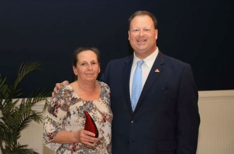 Katherine Myers (left), School Nutrition Assistant at Smithfield-Selma High, was selected as the Employee of the Year for her field. Standing with her is JCPS Superintendent Dr. Ross Renfrow (right).
