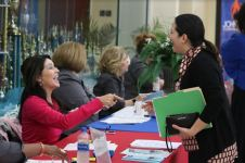 Johnston County Public Schools employee Carolyn Rotondaro (left) helps to check in Tiliza Cardenas (right) at the JCPS Job Fair on April 13.