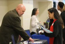 Johnston County Public Schools Executive Director of Beginning Educator Support Dr. Todd Holmes (left) talks with Stephanie Lino-Perez (right) about the resources that are available for new teachers in the district.