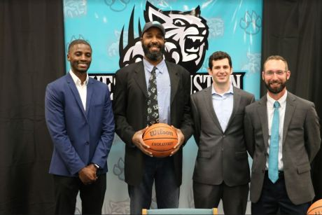 West Johnston High School named its new boys basketball head coach Chucky Brown at a special news conference. Photographed (from left) are junior varsity boys basketball head coach Willy Akasson, Chucky Brown, WJHS Administrator of Athletics Chris Lattimer, and WJHS Athletic Director Josh Plisko.