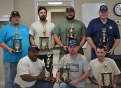 The winners of the NC DOT Safety 'Roadeo' from left top row: Donnie Taylor; John Barefoot, Kyle Sanders and Marshall New; kneeling from left are Dan Evans, Clifton Jenkins and Wayne Boone.