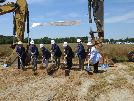 State and local officials along with representatives from Ashley Furniture break ground on a new retail outlet and distribution center on Brewer Road off Highway 96 South in Four Oaks on Tuesday. JoCoReport.com Photo