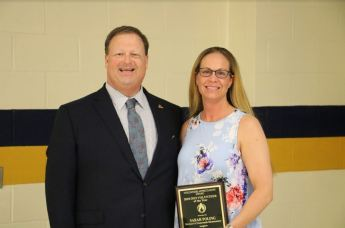 Sarah Poling (right) of McGee's Crossroads Elementary School was named the 2019 Johnston County Public Schools Adult Volunteer of the Year at the annual PTA/PTO Council Meeting Banquet, held at Smithfield-Selma High School on April 16. Standing with Poling is Johnston County Public Schools Superintendent Dr. Ross Renfrow (left).