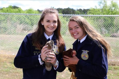Cleveland High students Abby Pleasant (left) and Olivia Bondurant (right) show off some of the animals they will work with in their agriculture education classes.