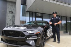 Clayton Police Traffic Safety Officer Timothy Marquis with his new 2019 Ford Mustang GT patrol car.