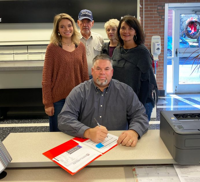 Mike Powell (seated) files on Dec. 16, 2019 for the District 6 seat on the Johnston County Board of Commissioners. Standing left to right are his daughter, Carson, parents Leon and Carolyn Powell, and his wife, Kim.