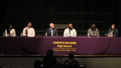 Corinth Holders High School hosted the We Are One: A Unity Forum on March 5. Panelists included (from left) Corinth Holders High student Jordan DeLoatch, Corinth Holders High student Nathan Campbell, Corinth Holders High Principal Brian Johnson, community member Fred Foreman, JCPS Communication Specialist James Summers, and JCPS MTSS Advanced Learning Coach Emily Hargrove. Moderating the event was JCPS Chief of Equity, Information and Student Services Crystal Roberts (front left) along with JCPS Executive Director of Equity Dee Edmundson (front right).