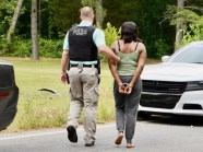 Kymisha Lashon Terry is led away in handcuffs after her arrest May 19, 2020 following a high speed chase with Selma Police.