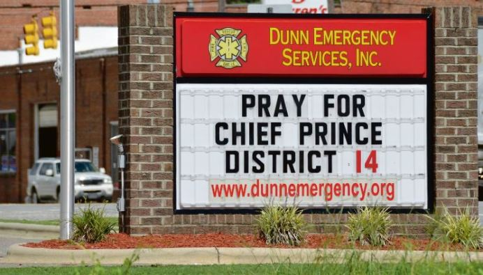 The Dunn Emergency Services sign asks for prayer for Northwest Harnett Fire Department Chief Chris Prince. Prince is currently in critical condition in ICU at an area hospital, battling COVID-19 and pneumonia. Dunn Daily Record Photo